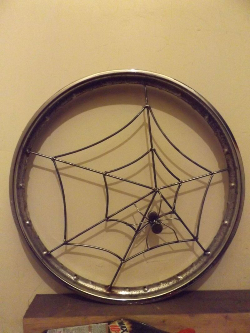 Recycled motorcycle wheel rim with recycled clothes dryer: Swipe To View More Images